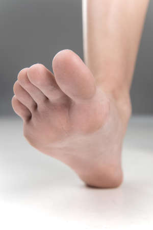 Women beautiful Foot stepping closeup. feet walking on floor with fingers closeup photo