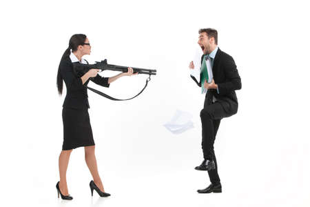 quarrel between man and woman over white background. side view of woman standing and pointing at man with gun Imagens