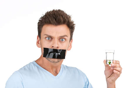 wants: young man wants to stop drinking. closeup of man with alcohol and tape over mouth