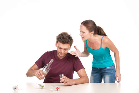alcoholic man: Man drinking alcohol and woman shouting at him. Photo of family conflict with alcoholic husband on white background