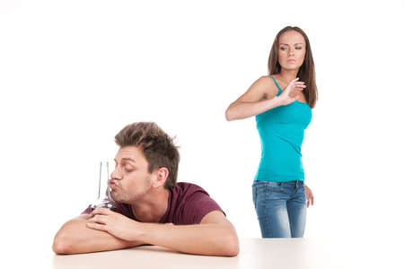 dumped: Man drinking alcohol and woman leaving him. Photo of family conflict with alcoholic husband on white background
