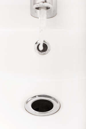 sink drain: stainless steel kitchen sink drain. Bathroom interior with white sink and silver faucet Stock Photo