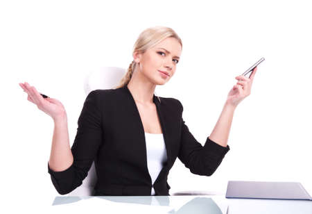 undersign: Portrait of business woman sitting on her desk. beautiful young blond raising hands in surprise