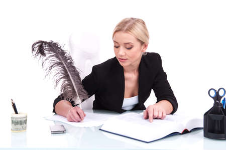 Young businesswoman working on white background. beautiful young woman writing at table using feather photo
