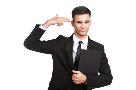 young businessman doing suicide symbol on white.  businessman shooting his own head with his fingers  photo