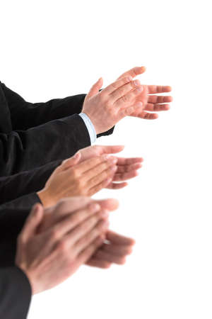 closeup of business people hands applauding at white background. Photo of business partners hands applauding at meeting