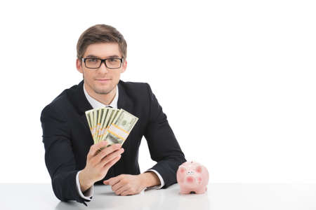 Business man holding dollar bills, isolated on white. Young businessman showing money in office Standard-Bild