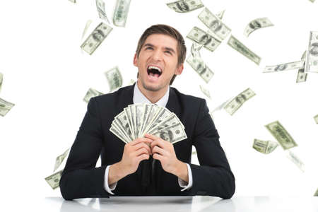 Business man holding dollar bills and yelling. Young businessman showing money in office Standard-Bild