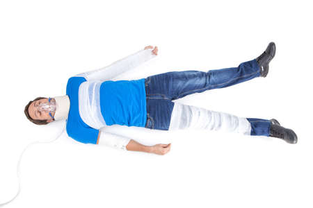young man lying with cervical collar. top view of young man with broken hand in gypsum photo