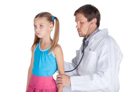 Stethoscope listening to girls heart beat. doctor examining girl on white background photo