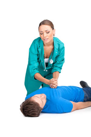 doctor giving cardiopulmonary resuscitation to man. young girl trying to save guy lying on white background photo