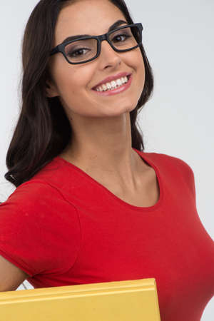 Portrait of happy smiling young woman. girl wearing red t-shirt, isolated over white background  photo