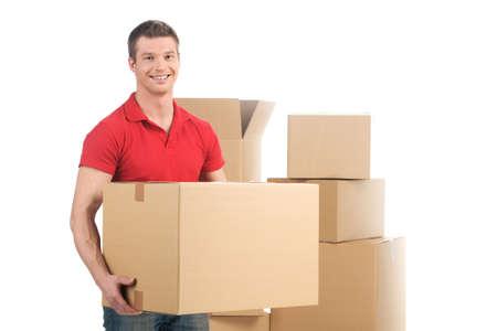 Man met bewegende doos en glimlachend in de camera. jonge man met kartonnen dozen Stockfoto - 32577525