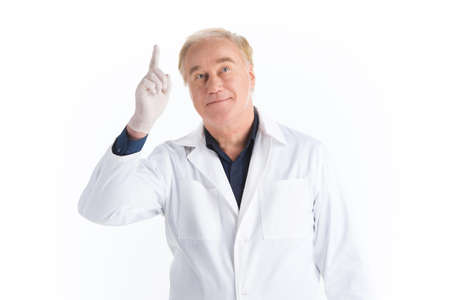 scientist man: scientist holding hand up and pointing to blank. adult man standing on white background and thinking with raised hand up
