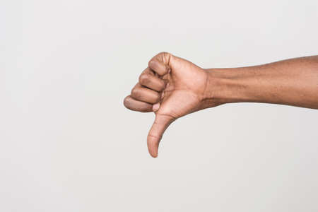 thumb: Thumb down hand signs isolated on white. black man hand gesturing with hand on white