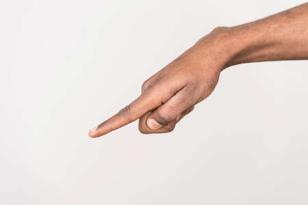 black man hand on white background. isolated african male hand touching or pointing to something photo