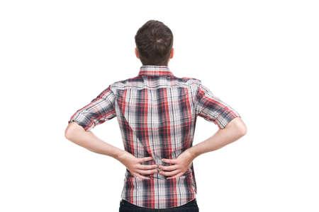 personas de espalda: hombre joven sosteniendo su mano en la espalda dolorida. Foto de archivo