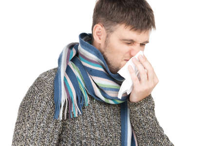allergy man blowing his nose in tissue paper.  photo