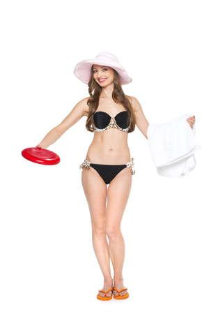 disco volante: Ragazza sexy con asciugamano e disco volante su sfondo bianco.
