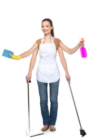 four hands: Young smiling woman isolated over white background. beautiful brunette with four hands and cleaning tools Stock Photo