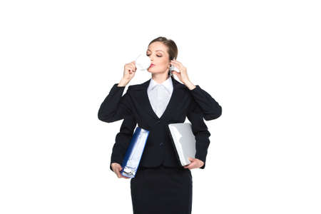 Portrait of smiling business woman phone talking on white background. Beautiful woman holding folders and talking on cellphone with four arms photo