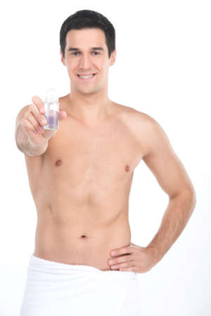 armpits: Young handsome men holding deodorant for armpits. nude man standing on white background and smiling