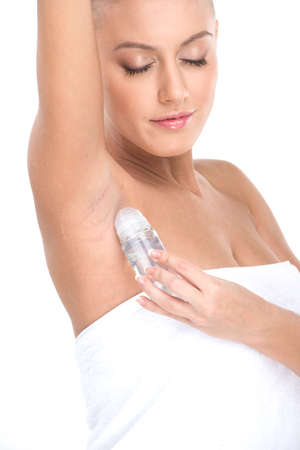 woman applying deodorant in armpit on white background. Beautiful beauty woman putting antiperspirant stick deodorant in underarms photo