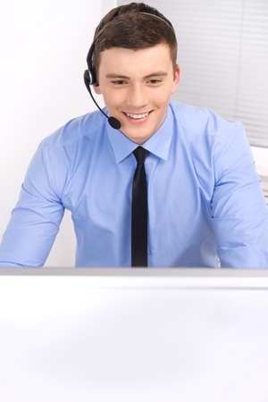 handsome technical support operator working on computer. businessman with headset portrait at bright call center helpdesk support office Stock fotó