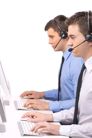 Customer service employee with headphones on white. two men working in call center on white background