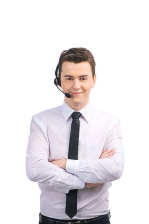 Portrait of customer service representative standing arms crossed. man with headset standing over white background