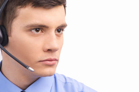 call center representative: handsome technical support operator working on white.  Stock Photo