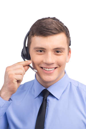 helpdesk: handsome technical support operator working on white.  Stock Photo