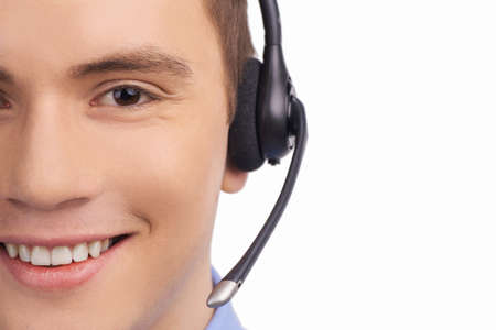 Closeup of smiling customer service agent with headset.