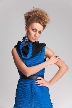 beautiful blonde woman wearing blue dress. knitted dress without sleeves on pretty girl Stock fotó