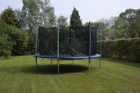 Trampolin in sunny garden