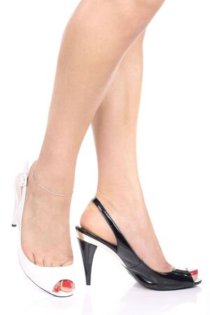 Woman's leg and black and white shoes Stock Photo - 3954540