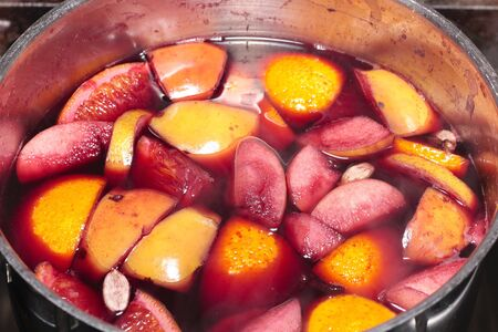 Mulled wine in saucepan closeup