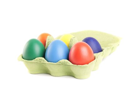Colored Easter eggs in carton photo