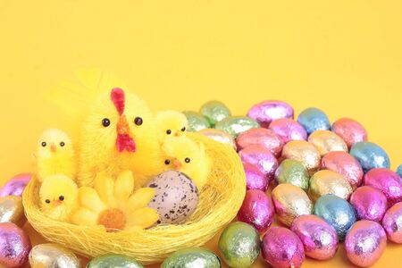 Easter eggs over yellow background photo