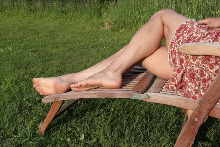 Woman relaxing on  sunny meadow Stock Photo - 5542724