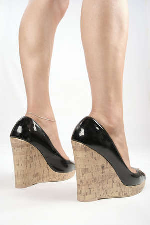 Woman legs with black high heel shoes over white Stock Photo - 5908086
