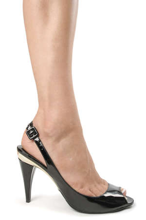 Woman legs with black high heel shoes over white Stock Photo - 5908078
