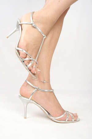 Woman legs with silver high heel shoes over white Stock Photo - 5908079