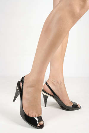 Woman legs with black high heel shoes over white Stock Photo - 6002550