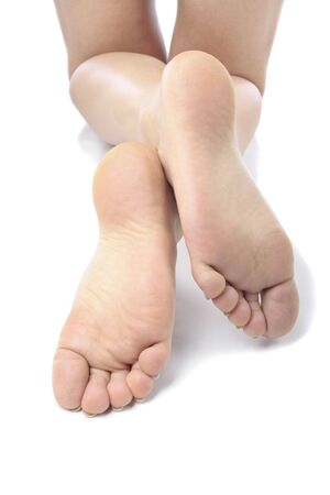 Woman feet and  legs isolated over white background Stock Photo