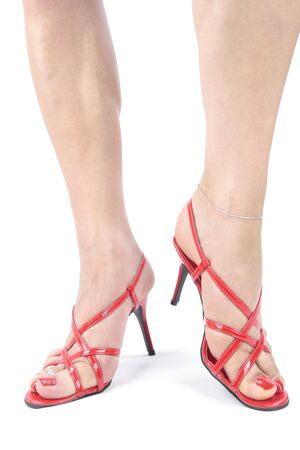 Woman legs with red  high heel shoes over white photo