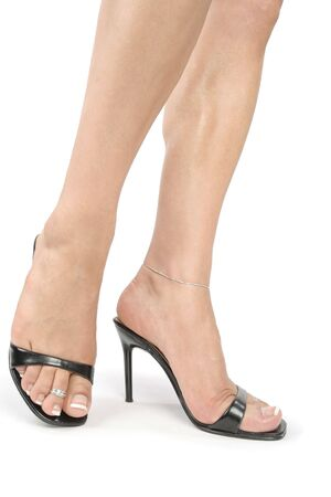 Woman feet and legs with black high heel shoes over white Stock Photo - 6182189