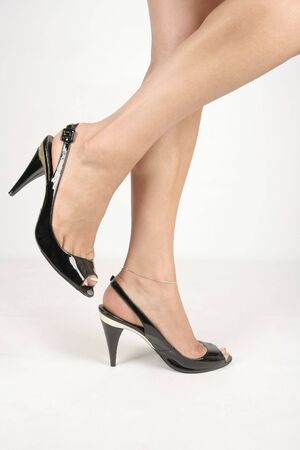 Woman legs with black high heel shoes over white Stock Photo - 6217387
