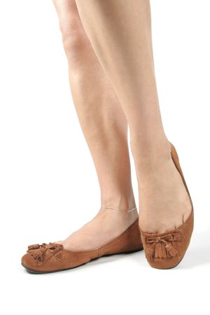 Woman legs with brown moccasin shoes over white Stock Photo - 6217388