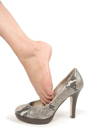 Woman legs with high heel shoes over white Stock Photo - 6217393